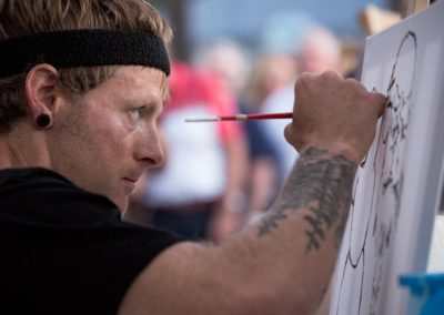 Competitive painting at Battle Of The Brushes. Photo: Will Skol
