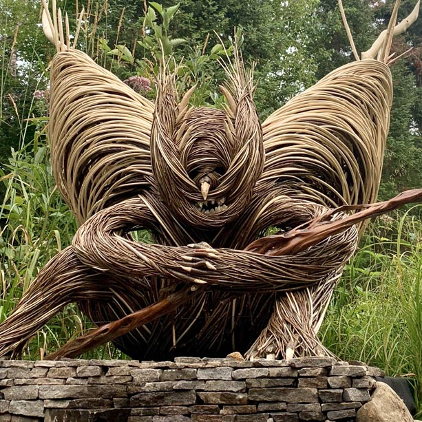 A sculpture made of woven branches.